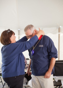 Jane Anderson places Alpha Sig purple heart on husband, Tux #864, for wounded arm sustained in GDI war of 1972